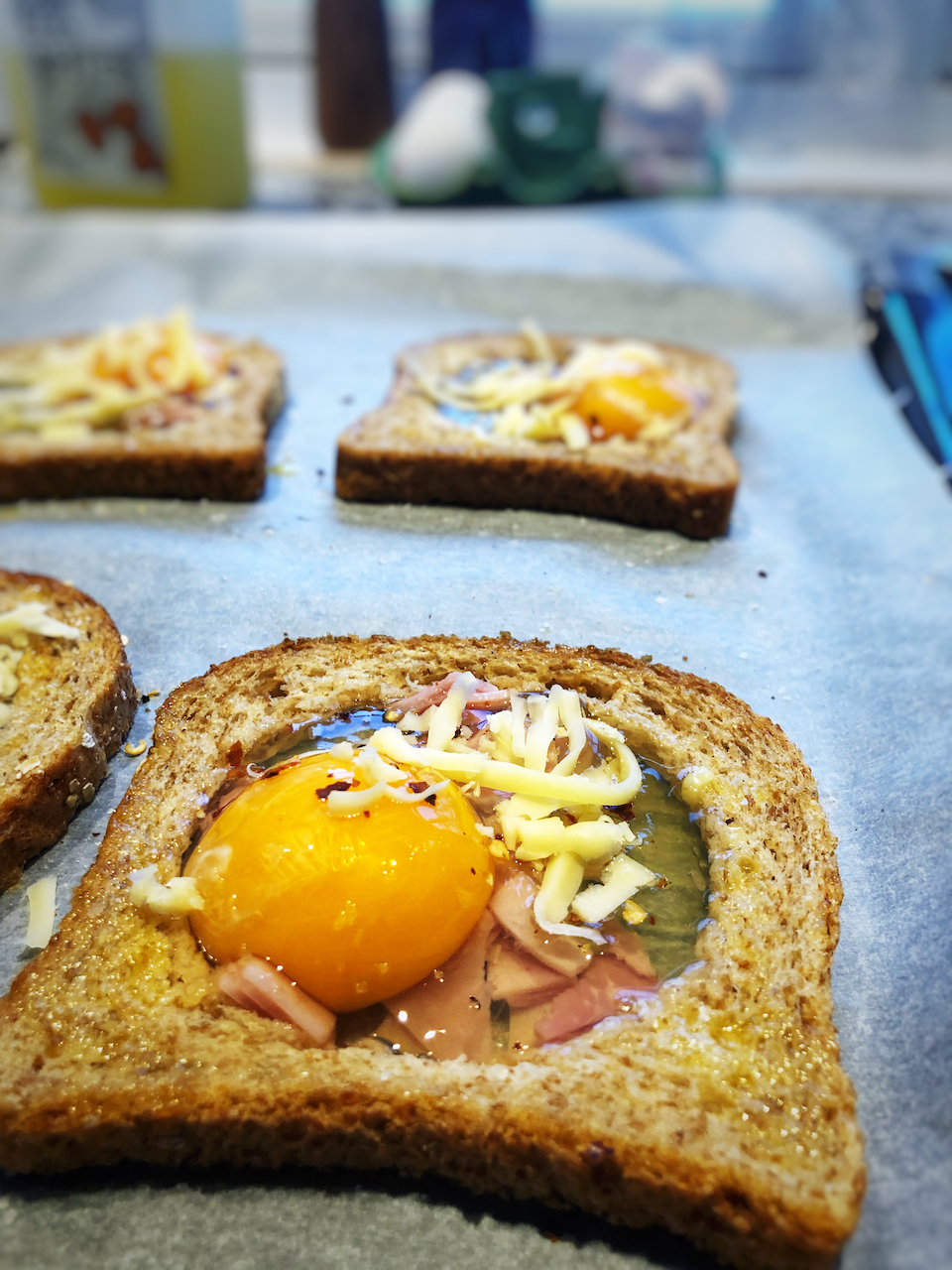 Crack one egg on top of the ham (in the hole in the bread)
